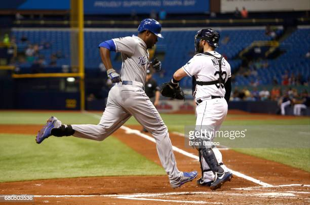 Lorenzo Cain of the Kansas City Royals scores in front of catcher Derek Norris of the Tampa Bay Rays off of an error by center fielder Kevin...