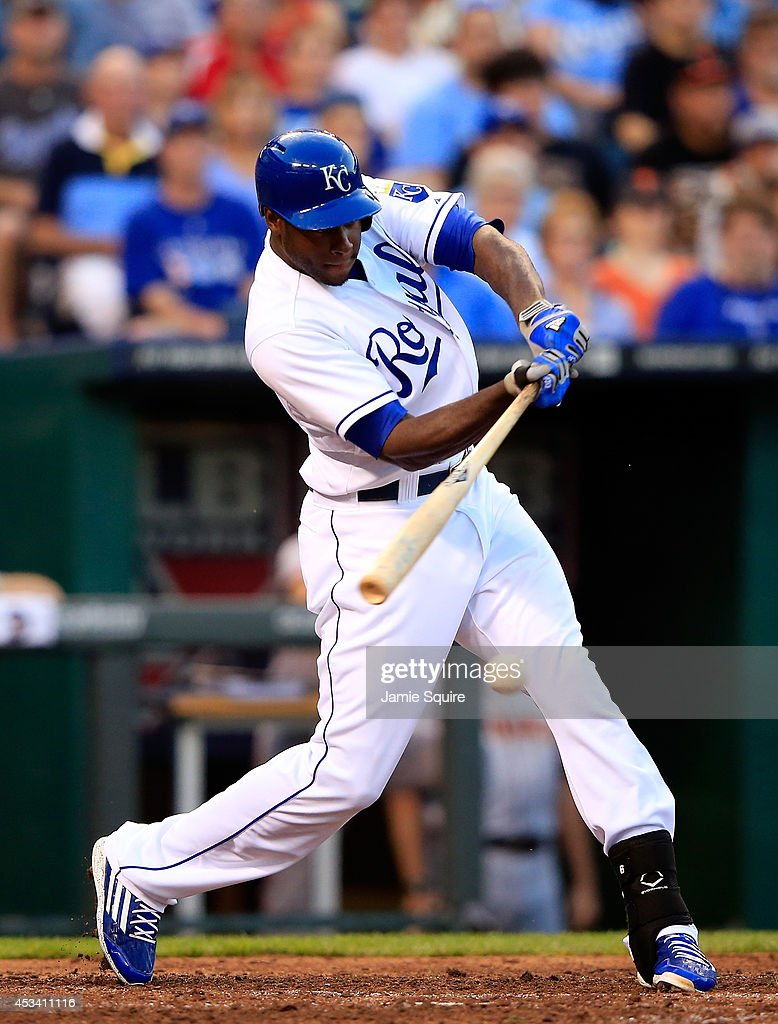 Lorenzo Cain #6 of the Kansas City Royals singles to drive in Billy Butler #16 for the Royals second run during the 7th inning of the game against the San Francisco Giants at Kauffman Stadium on August 9, 2014 in Kansas City, Missouri.