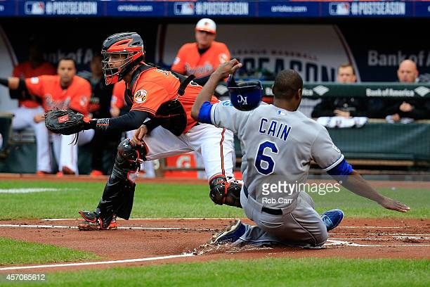 Lorenzo Cain of the Kansas City Royals slides save to home plate on Eric Hosmer of the Kansas City Royals single to left field also scoring Norichika...