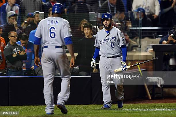 Lorenzo Cain of the Kansas City Royals walks back to the dugout after scoring a run off of a double hit by Eric Hosmer of the Kansas City Royals in...