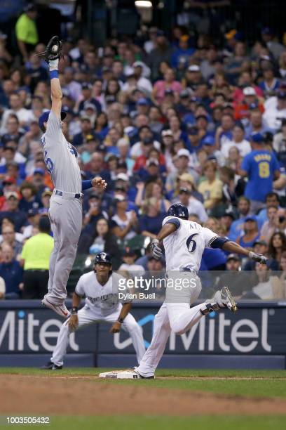 Lorenzo Cain of the Milwaukee Brewers beats out a force out attempt by Cody Bellinger of the Los Angeles Dodgers in the third inning at Miller Park...