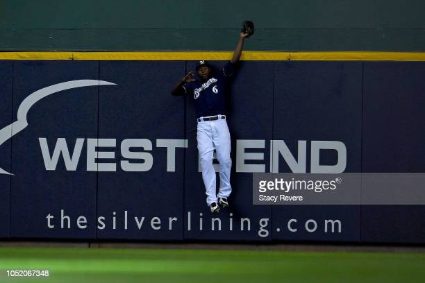 Lorenzo Cain of the Milwaukee Brewers catches a pop up fly hit by David Freese of the Los Angeles Dodgers during the first inning in Game Two of the...