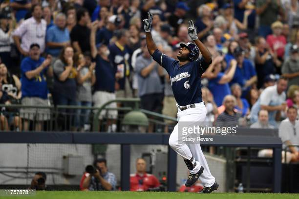 Lorenzo Cain of the Milwaukee Brewers celebrates a home run against the San Diego Padres during the fourth inning at Miller Park on September 19,...