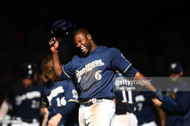 Lorenzo Cain of the Milwaukee Brewers celebrates after scoring the game winning run against the St Louis Cardinals at Miller Park on March 31 2019 in...