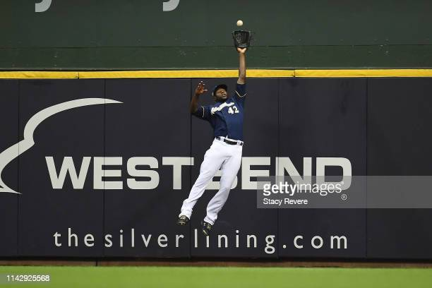 Lorenzo Cain of the Milwaukee Brewers fields a fly ball during the second inning of a game against the St Louis Cardinals at Miller Park on April 15...