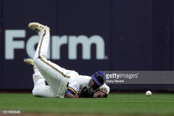 Lorenzo Cain of the Milwaukee Brewers is unable to field a fly ball during the first inning against the St. Louis Cardinals at American Family Field...