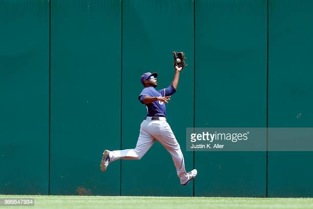 Lorenzo Cain of the Milwaukee Brewers makes a running catch in the second inning against the Pittsburgh Pirates at PNC Park on July 15 2018 in...
