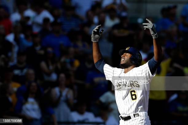 Lorenzo Cain of the Milwaukee Brewers reacts while crossing home plate after a two run homer in the seventh inning against the Washington Nationals...