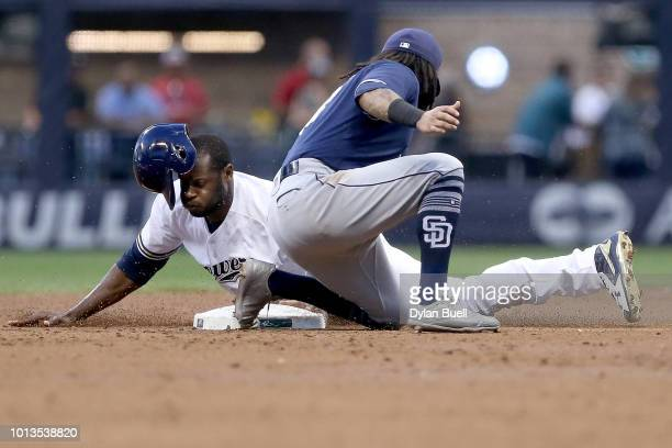 Lorenzo Cain of the Milwaukee Brewers steals second base past Freddy Galvis of the San Diego Padres in the second inning at Miller Park on August 8...