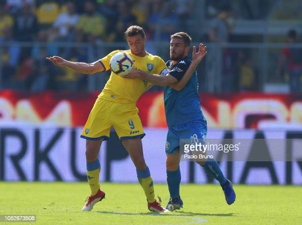 Lorenzo Capezzi of Empoli competes for the ball with Daniel Ciofani of Frosinon e Calcio during the Serie A match between Frosinone Calcio and Empoli...