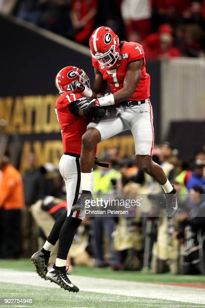 Lorenzo Carter and Davin Bellamy of the Georgia Bulldogs celebrate a third down stop during the second quarter against the Alabama Crimson Tide in...
