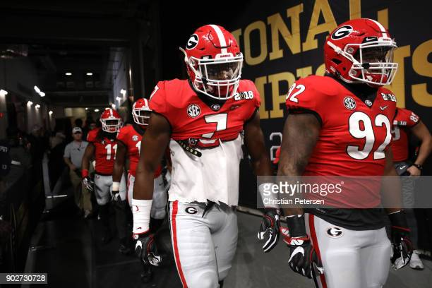 Lorenzo Carter of the Georgia Bulldogs and Justin Young walk out of the tunnel during warm ups before the game against the Alabama Crimson Tide in...