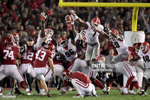 Lorenzo Carter of the Georgia Bulldogs blocks the field goal attempt from Austin Seibert of the Oklahoma Sooners in the 2018 College Football Playoff...
