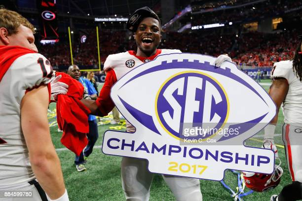 Lorenzo Carter of the Georgia Bulldogs celebrates beating the Auburn Tigers in the SEC Championship at MercedesBenz Stadium on December 2 2017 in...
