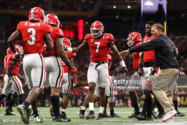 Lorenzo Carter of the Georgia Bulldogs reacts to a play during the first quarter against the Alabama Crimson Tide in the CFP National Championship...
