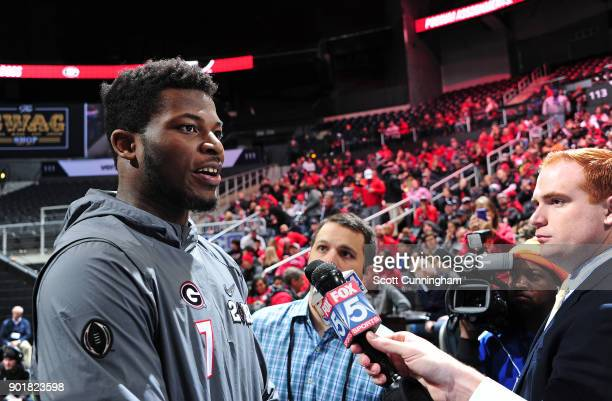 Lorenzo Carter of the Georgia Bulldogs speaks to the media during the College Football Playoff National Championship Media Day at Philips Arena on...