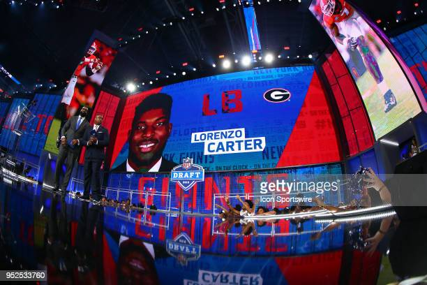 Lorenzo Carter on the video board after being chosen by the New York Giants with the 66th pick during the third round of the 2018 NFL Draft on April...