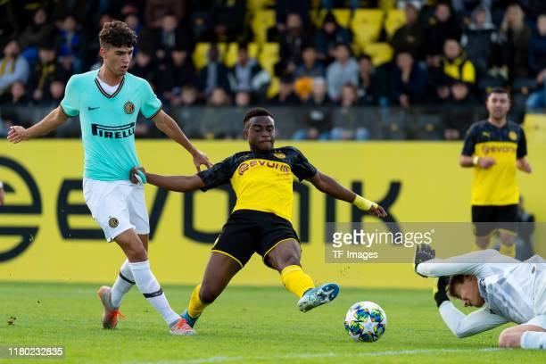 Lorenzo Colombini of Inter Mailand U19 Youssoufa Moukoko of Borussia Dortmund U19 and goalkeeper Filip Stankovic battle for the ball during the UEFA...