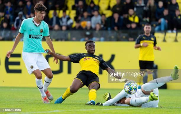 Lorenzo Colombini of Inter Mailand U19, Youssoufa Moukoko of Borussia Dortmund U19 and goalkeeper Filip Stankovic battle for the ball during the UEFA...