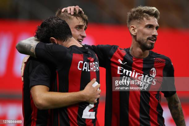 Lorenzo Colombo of AC Mialn celebrates with team mates Davide Calabria and Samuel Castillejo after scoring to give the side a 21 lead during the UEFA...