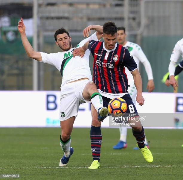 Lorenzo Crisetig of Crotone competes for the ball with Luca Mazzitelli of Sassuolo during the Serie A match between FC Crotone and US Sassuolo at...