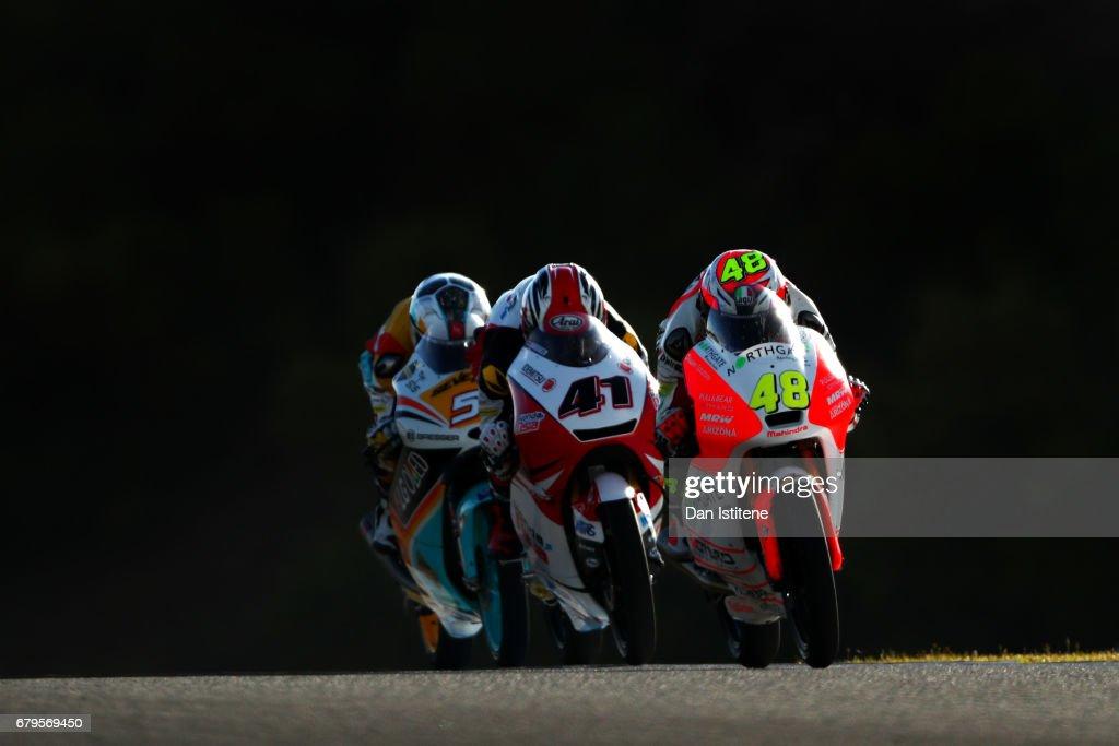 Lorenzo Dalla Porta of Italy and Aspar Mahindra Moto3 rides ahead of Nakarin Atiratphuvapat of Thailand and Honda Team Asia and Romano Fenati of Italy and Marinelli Rivacold Snipers during final practice for Moto3 at Circuito de Jerez on May 6, 2017 in Jerez de la Frontera, Spain.