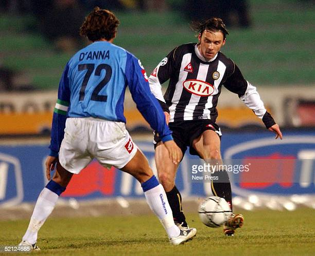 Lorenzo D'Anna of ChievoVerona struggles for the ball with Marek Jankulovski of Udinese during their match at the Friuli stadium February 2 2005 in...