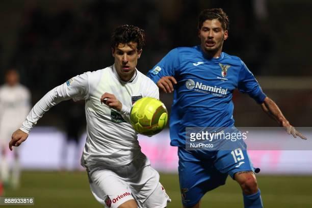 Lorenzo De Grazia of Teramo Calcio 1913 compete for the ball with Alberto Torelli of Alma Juventus Fano 1906 during the Lega Pro 17/18 group B match...