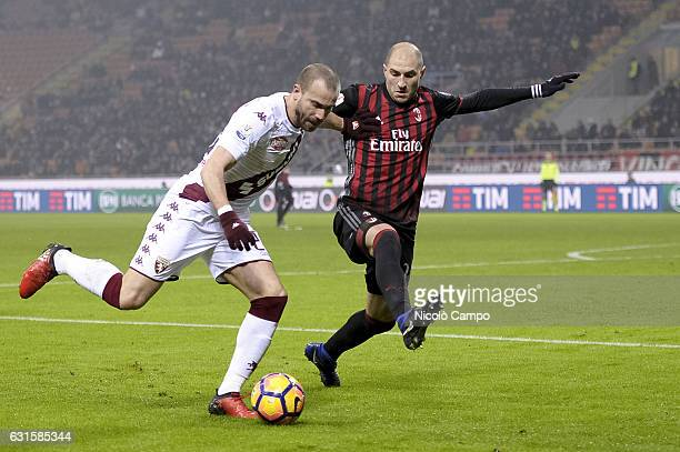 Lorenzo De SIlvestri of Torino FC and Gabriel Paletta of AC Milan compete for the ball during the Tim Cup football match between AC Milan and Torino...