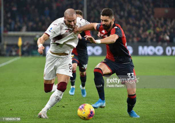 Lorenzo De Silvestri of Torino FC battles for the ball with Marko Pajac of Genoa CFC during the Serie A match between Genoa CFC and Torino FC at...