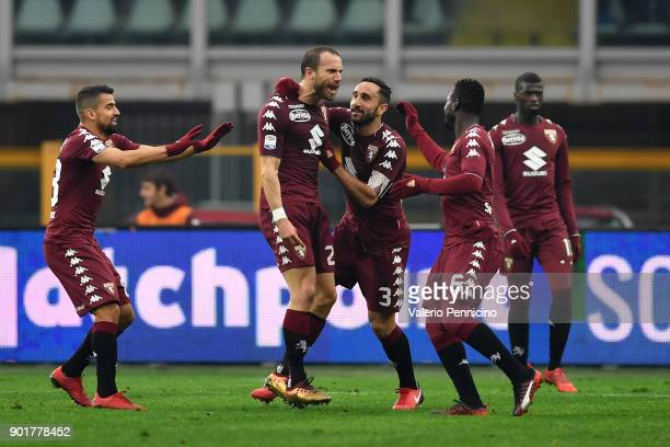 Lorenzo De Silvestri of Torino FC celebrates after scoring the opening goal with team mates during the serie A match between Torino FC and Bologna FC...