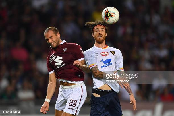 Lorenzo De Silvestri of Torino FC clashes with Andrea Tabanelli of US Lecce during the Serie A match between Torino FC and US Lecce at Stadio...