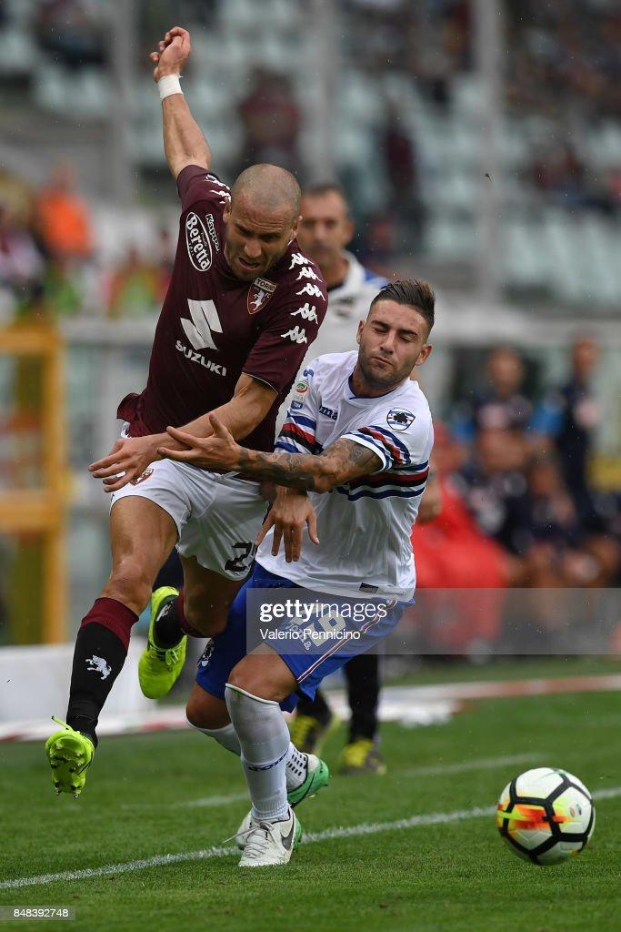 Lorenzo De Silvestri (L) of Torino FC clashes with Nicola Murru of UC Sampdoria during the Serie A match between Torino FC and UC Sampdoria at Stadio Olimpico di Torino on September 17, 2017 in Turin, Italy.