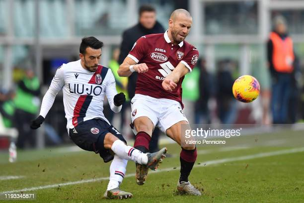 Lorenzo De Silvestri of Torino FC clashes with Nicola Sansone of Bologna FC during the Serie A match between Torino FC and Bologna FC at Stadio...