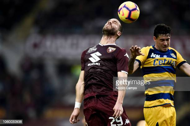Lorenzo De Silvestri of Torino FC competes for a header with Alessandro Bastoni of Parma Calcio during the Serie A football match between Torino FC...