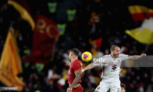 Lorenzo De Silvestri of Torino FC competes for the ball with Aleksandar Kolarov of AS Roma during the Serie A match between AS Roma and Torino FC at...
