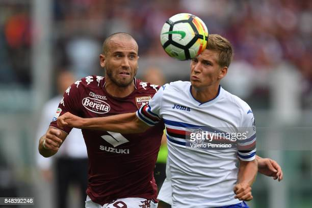 Lorenzo De Silvestri of Torino FC competes with Dennis Praet of UC Sampdoria during the Serie A match between Torino FC and UC Sampdoria at Stadio...