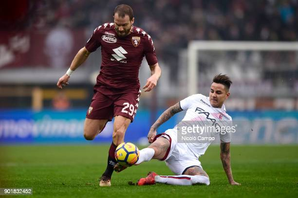 Lorenzo De Silvestri of Torino FC is tackled by Erick Pulgar of Bologna FC during the Serie A football match between Torino FC and Bologna FC Torino...