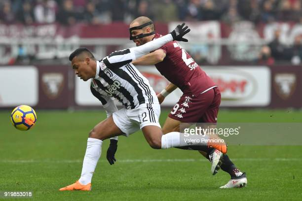 Lorenzo De Silvestri of Torino FC tackles Alex Sandro of Juventus during the Serie A match between Torino FC and Juventus at Stadio Olimpico di...