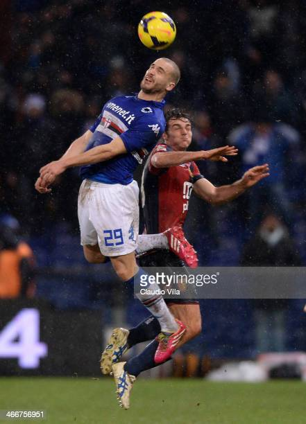 Lorenzo De Silvestri of UC Sampdoria and Paolo De Ceglie of Genoa CFC compete for the ball during the Serie A match between Genoa CFC and UC...