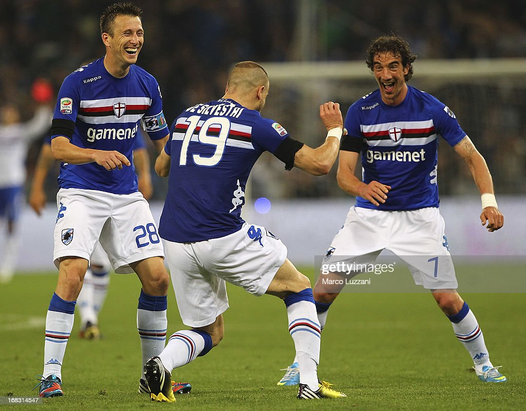 Lorenzo De Silvestri (C) of UC Sampdoria celebrates with his team-mates Paolo Castellini (R) and Daniele Gastaldello (L) after scoring after scoring the opening goal during the Serie A match between UC Sampdoria and Calcio Catania at Stadio Luigi Ferraris on May 8, 2013 in Genoa, Italy.
