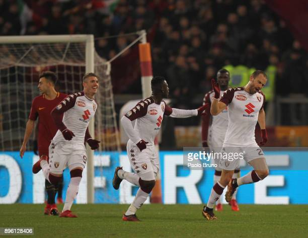 Lorenzo De Silvestri with his teammates of Torino FC celebrates after scoring the opening goal during the TIM Cup match between AS Roma and Torino FC...