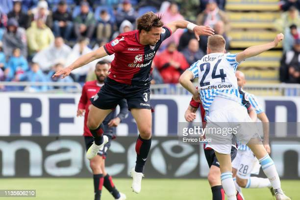 Lorenzo Dickmann of Spal and Luca Pellegrini of Cagliari during the Serie A match between Cagliari and SPAL at Sardegna Arena on April 7 2019 in...