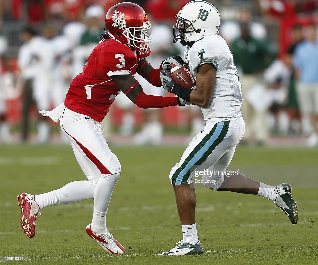 Lorenzo Doss #6 of the Tulane Green Wave takes he ball away from Deontay Greenberry #3 of the Houston Cougars at Robertson Stadium on November 24, 2012 in Houston, Texas. Houston defeats Tulane 40-17.