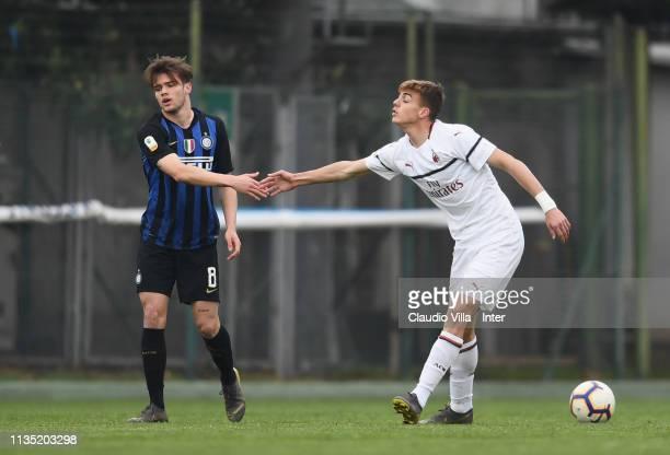 Lorenzo Gavioli of FC Internazionale and Daniel Maldini of AC Milan react during the Serie A Primavera match between FC Internazionale U19 and AC...