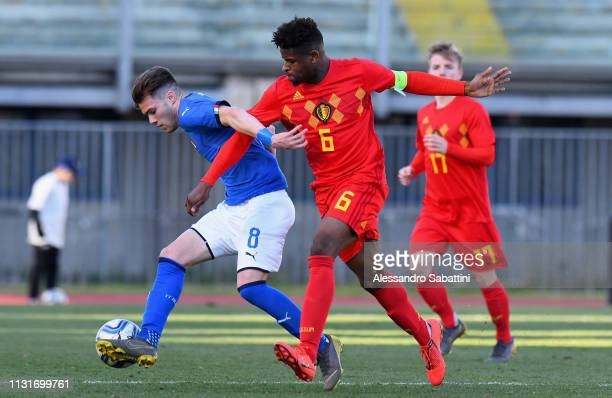 Lorenzo Gavioli of Italy U19 competes for the ball with Brandon Baiye of Belgium U19 during the UEFA Elite Round match between Italy U19 and Belgium...