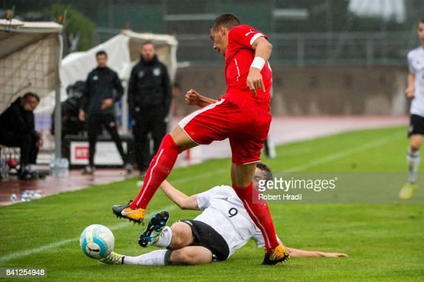 Lorenzo Gonzalez vies with Yari Otto during the U20 international friendly match between U19 Switzerland and U19 Germany on August 31 2017 at Stade...