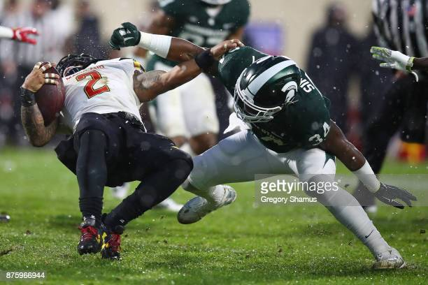 Lorenzo Harrison III of the Maryland Terrapins is tackled by Antjuan Simmons of the Michigan State Spartans during a first half run at Spartan...