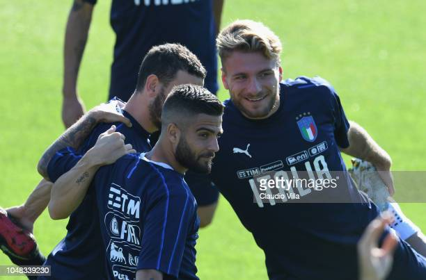 Lorenzo Insigne and Ciro Immobile of Italy chat during a Italy training session at Centro Tecnico Federale di Coverciano on October 9 2018 in...