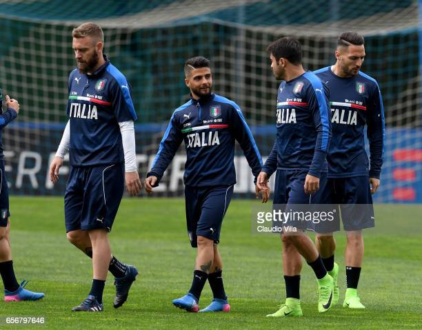 Lorenzo Insigne and Eder of Italy chat during the training session at the club's training ground at Coverciano on March 23 2017 in Florence Italy